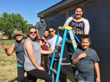 Members of Broadview Baptist Church paint a tiny house in the Houses for Healing addition on North Hickory Street sponsored by Sonrise Ministries.