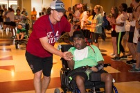 Hardin-Simmons University physical therapy student Davis Cantwell works with a special needs camper at the Joni & Friends Camp.