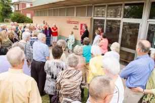A large crowd gathered May 9 to honor Frances Buzard, seated, as the food pantry sponsored by First Central Presbyterian Church was renamed in her honor. She was the longtime director of the pantry. Photo by Kristen Harris-Bridwell